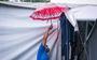 Công nhân dầm mưa xây dựng sân bóng đá Phú Nhuận thành khu cách ly F0